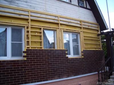 Процесс отделки дома фасадными панелями