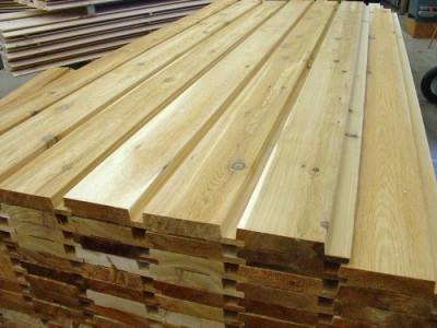 Деревянные рейки для отделки фасада дома