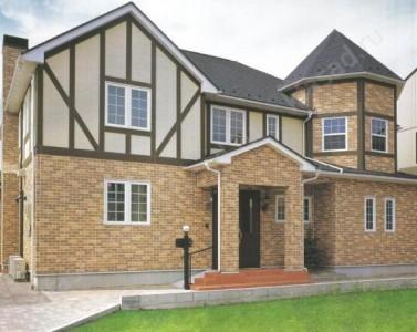 Пример отделки фасада дома фасадными панелями
