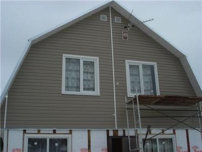 Пример отделки фасада дома сайдингом