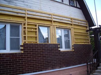 Утепление фасада дома из дерева