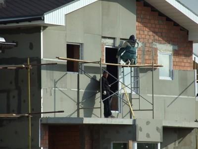 Процесс утепления фасадом домов
