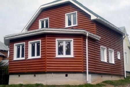 Бревенчатый сайдинг в отделке фасада дома