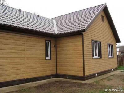Пример отделки фасада дома железным сайдингом