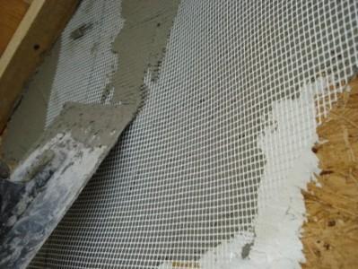 Нанесение штукатурки на фасадную сетку