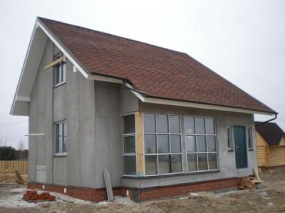 Дом, обшитий ЦПС перед финишной отделкой