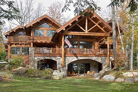 Красивый деревянный дом - цоколь из бутового камня